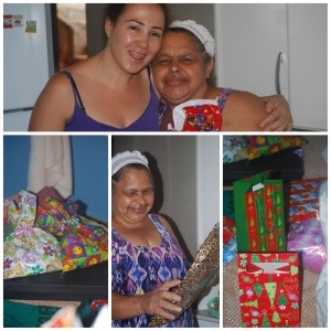 Aparecida receives her gifts from Vivi and family