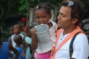 'Paudel' during the distribution of food to children living in camps
