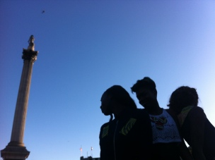 model behaviour... silhouette of models posing with Nelson's column looming above